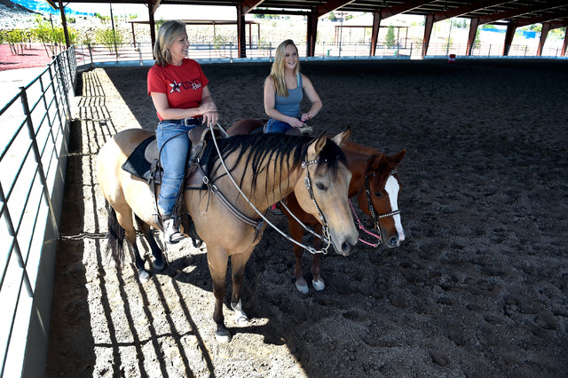 Kelly Griffith, left, and her daughter, Joey Griffith take a break as they ride their mares in the covered arena at the Lone Mountain Equestrian Park and Trail Tuesday, May 3, 2016, in Las Vegas.  ...