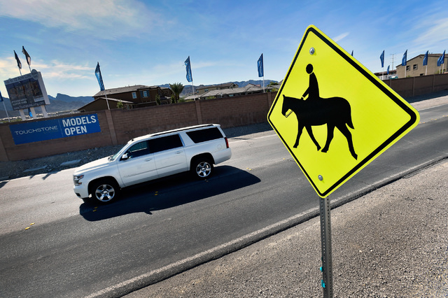An equestrian warning sign is seen along North Grand Canyon Drive near Craig Road Tuesday, May 3, 2016, in Las Vegas. David Becker/View