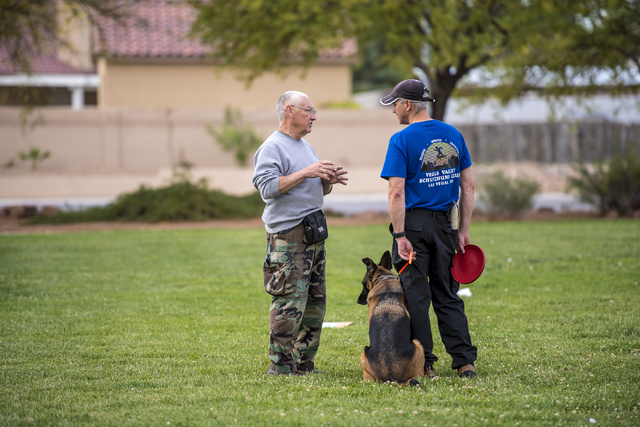 Bill Cassell, left, talks with Jeff Wagner during a Las Vegas Valley Schutzhund Club training session at Patriot Park in Las Vegas May 7, 2016. Joshua Dahl/View