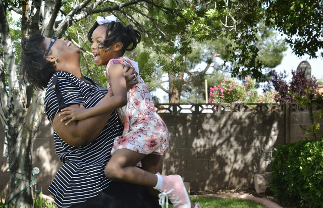 Donna Gamble plays with her adopted daughter Joy at their home in Las Vegas on Friday, April 22, 2016. (Bill Hughes/Las Vegas Review-Journal)