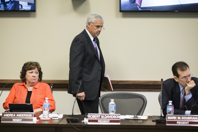 Chancellor Dan Klaich walks to his seat after speaking during a special meeting by the Board of Regents at the Nevada System of Higher Education building on Thursday, May 12, 2016, in Las Vegas. T ...