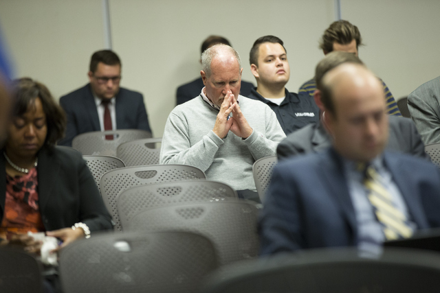 Audience members react to the Board of Regents voting to approve an early retirement deal with Chancellor Dan Klaich during a special meeting at the Nevada System of Higher Education offices on Th ...