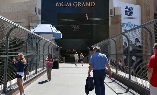 Tourists walk on the pedestrian bridge where a man was stabbed between New York-New York and the MGM Grand Wednesday, May 11, 2016. (Bizuayehu Tesfaye/Las Vegas Review-Journal Follow @bizutesfaye)