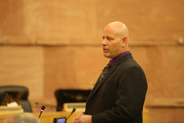 Conrad Claus, attorney for the family of Brian Keith Day, who was killed in an officer-involved shooting in July last year, asks a Metro detective questions during a use-of-force review at the Cla ...