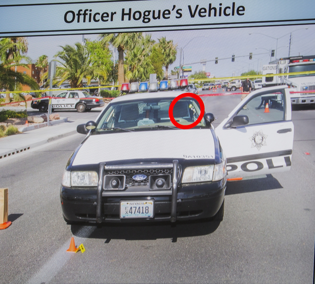 A video screen image shows where a bullet fired from suspect James Todora's gun ricocheted off the window and struck officer Evan Hogue, 28, during a fact-finding review at the Clark County Govern ...