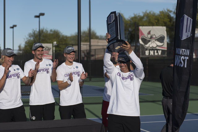 UNLV's Head Coach Owen Hambrook, right,  raises the Mountain West Conference men's tennis championship trophy following the schools victory at UNLV's Fertitta Tennis Complex in Las Vegas Sunday, M ...
