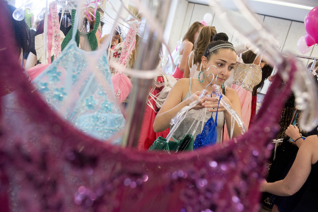 Hannah grabs dresses to try on during Operation That's My Dress, hosted by the USO in conjunction with Miss USA, at Bally's in Las Vegas on May 28, 2016. Bridget Bennett/Las Vegas Review-Journal F ...