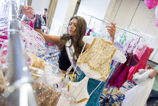 Miss Washington Kelsey Schmidt puts dresses back on the racks during Operation That's My Dress at Bally's in Las Vegas on May 28, 2016. Bridget Bennett/Las Vegas Review-Journal Follow @bridgetkbennett