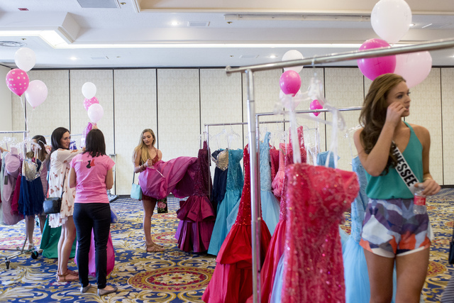 Women hunt for dresses during Operation That's My Dress, hosted by the USO in conjunction with Miss USA, at Bally's in Las Vegas on May 28, 2016. Bridget Bennett/Las Vegas Review-Journal Follow @b ...