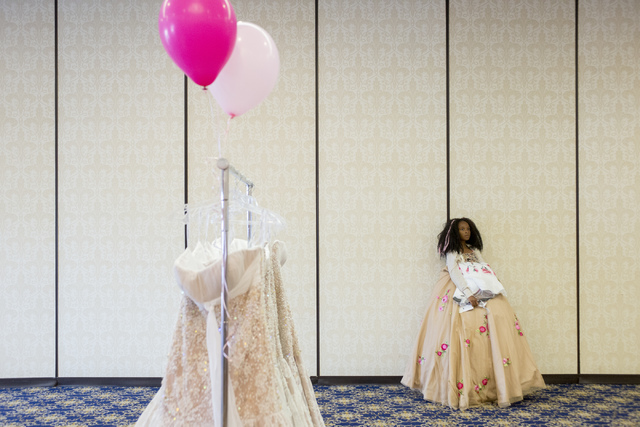 Anaiya Thompson holds dresses to try on during Operation That's My Dress, hosted by the USO in conjunction with Miss USA, at Bally's  in Las Vegas on May 28, 2016. Bridget Bennett/Las Vegas Review ...