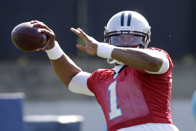Carolina Panthers quarterback Cam Newton looks to pass during NFL football practice in Charlotte, N.C., Tuesday, May 24, 2016. (Chuck Burton/AP)