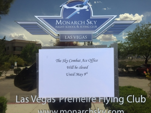 A note taped to the entrance Monday, for Sky Combat Ace and Monarch Sky offices near Henderson Executive Airport says Sky Combat Ace's office will be closed until May 9. A Sky Combat Ace instructo ...