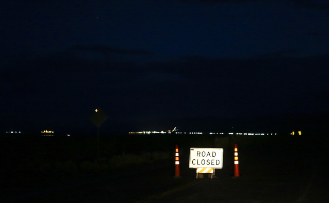 A road closure sign is shown along Las Vegas Boulevard near Jean, Nev. after a single engine airplane crashed, leaving two dead, near the area on Saturday, April 30, 2016. Chase Stevens/Las Vegas  ...
