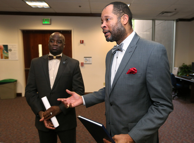 Nevada Senate Democrats Kelvin Atkinson, left, and Aaron Ford talk Friday night about a measure that would appropriate $1.3 million to equip Nevada Highway Patrol troopers with body cameras by 201 ...