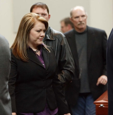 IElissa Wall, front, with her husband Lamont Barlow, immediately behind her, stand during her lawsuit against polygamous leader Warren Jeffs at Utah Supreme Court in Salt Lake City in 2009. (Trent ...