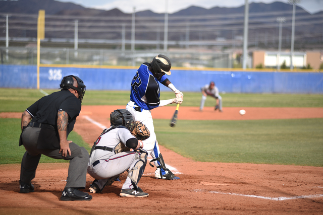 basics jj smith 22 swings at a pitch against liberty during their baseball game