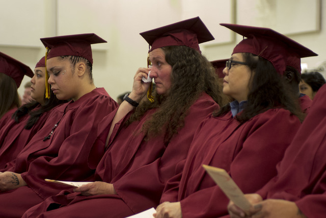 Inmate Karen Bodden wipes tears from her eyes prior to receiving her high school diploma during Florence McClure Women's Correctional Center's graduation ceremony in Las Vegas on May 25, 2016. (Br ...