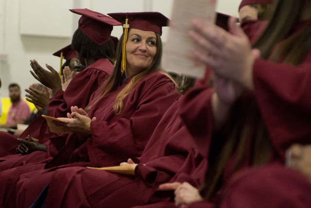 Inmate Jennifer Patrick applauds during Florence McClure Women's Correctional Center's graduation ceremony in Las Vegas on May 25, 2016. (Bridget Bennett/Las Vegas Review-Journal) Follow @bridgetk ...