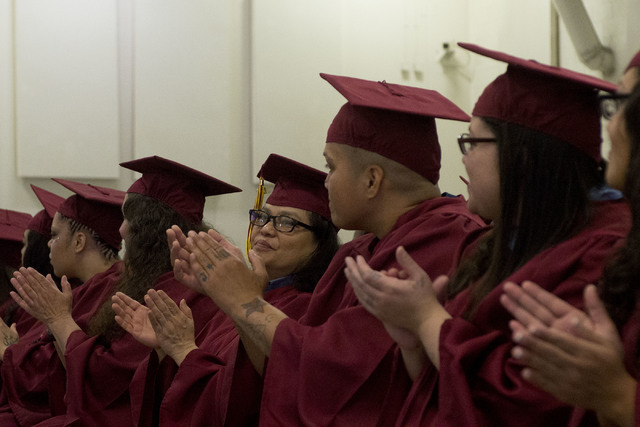 Inmates applaud prior to receiving their high school diplomas during Florence McClure Women's Correctional Center's graduation ceremony in Las Vegas on May 25, 2016. (Bridget Bennett/Las Vegas Rev ...