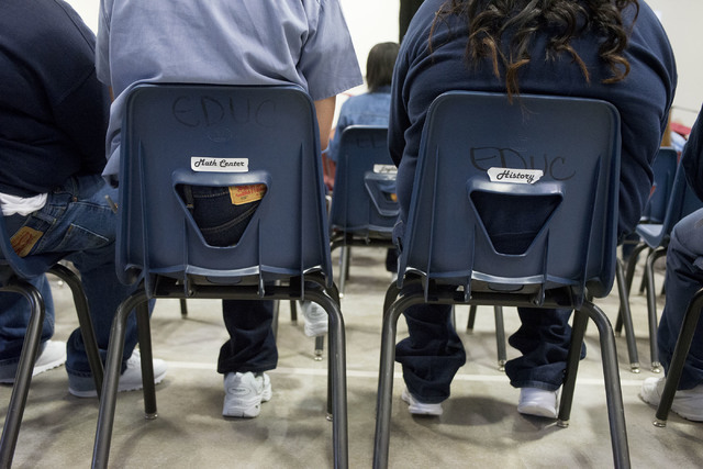 Inmates watch fellow inmates receive their diplomas during Florence McClure Women's Correctional Center's graduation ceremony in Las Vegas on May 25, 2016. (Bridget Bennett/Las Vegas Review-Journa ...