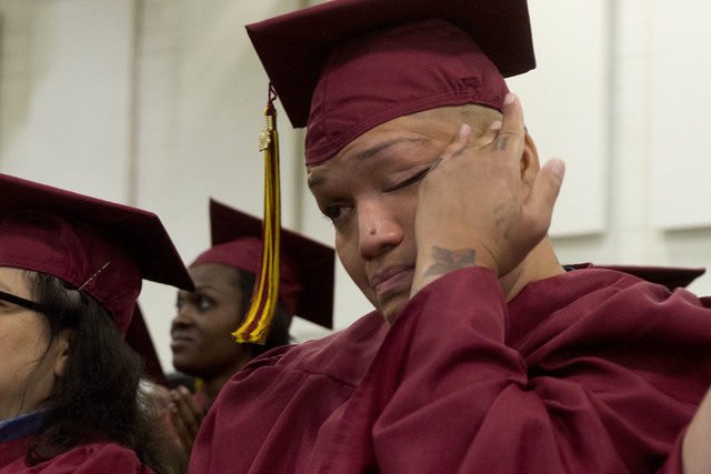 Inmate Sesha Awa wipes tears from her eyes during Florence McClure Women's Correctional Center's graduation ceremony in Las Vegas on May 25, 2016. (Bridget Bennett/Las Vegas Review-Journal) Follow ...