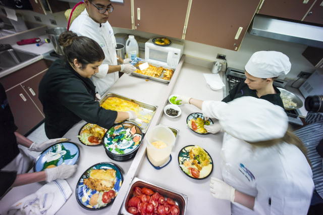 Students get ready to serve lunch as part of the ProStart program at Silverado High School May 5, 2016. Chase Stevens/View