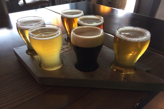 A sampler of beers is seen April 7, 2016, at PT's Brewing Co. on a wooden tray cut in the shape of Nevada and emblazoned with the PT's logo. A special event is being planned for the fall, when h ...