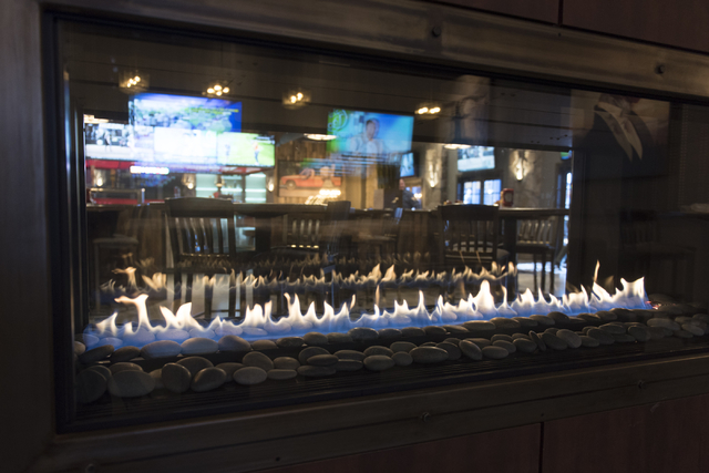 The fireplace at the soon to be opened PT's Ranch at 6450 S. Durango Dr. in Las Vegas is seen Thursday, May 19, 2016. The tavern, slated to open Thursday, May 26, 2016, will be the 50th launched b ...
