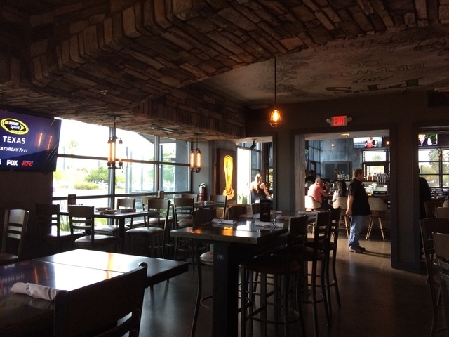 Where the outside now offers an industrial look, the inside of PT's Brewing Co. is more like a wine cellar. Faux stone arches, seen April 7, 2016, cross the the dining area, and the ceiling featur ...