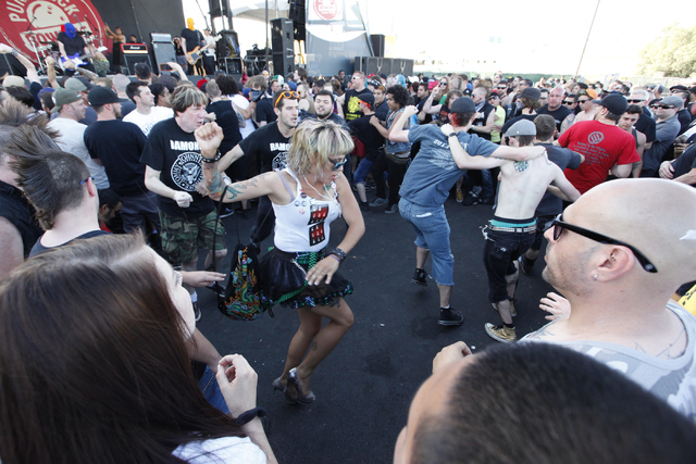 Fans dance and mosh as Masked Intruder performs at the Punk Rock Bowling music festival in downtown Las Vegas on Saturday, May 24, 2014. (Chase Stevens/Las Vegas Review-Journal)