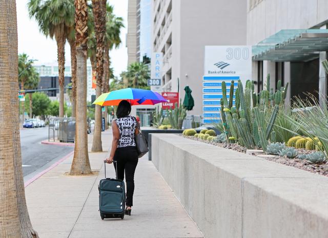 A woman walks in a light rain along 4th Street near Bridger Avenue Tuesday, May 17, 2016, in downtown Las Vegas. (Ronda Churchill/Las Vegas Review-Journal)