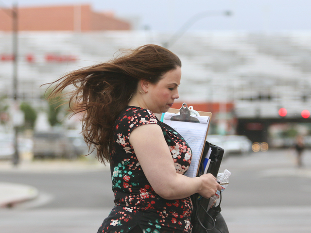 A woman is caught in the wind while crossing Casino Center Boulevard Tuesday, May 17, 2016, in downtown Las Vegas. (Ronda Churchill/Las Vegas Review-Journal)