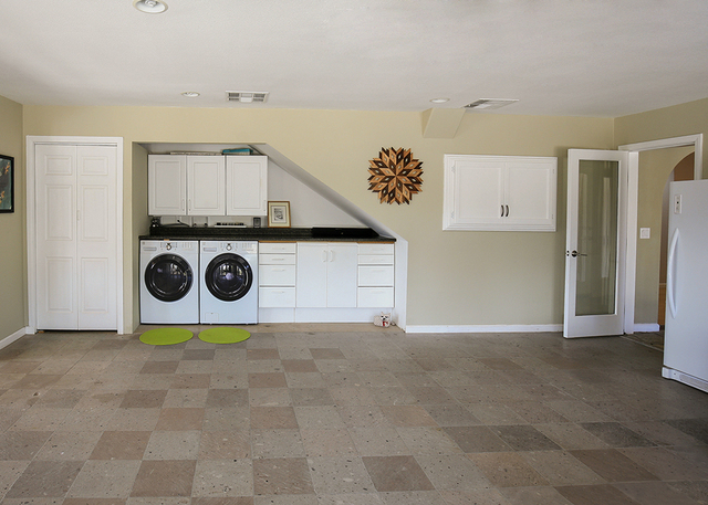 The large laundry room of the 3,426-square-foot home in Bonnie Springs. (ELKE COTE/MILLIONS)
