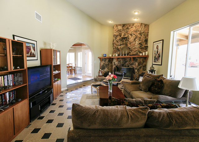 The living room of the Bonnie Springs house has a stone fireplace. (ELKE COTE/MILLIONS)