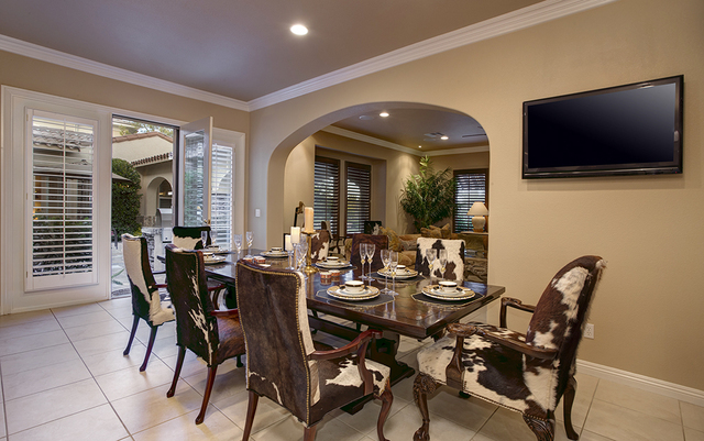 COURTESY OF SYNERGY, SOTHEBY'S INTERNATIONAL REALTY The dining room of the 3,936-square-foot, Tuscan-style residence at 11856 Brigadoon Drive in Southern Highlands.
