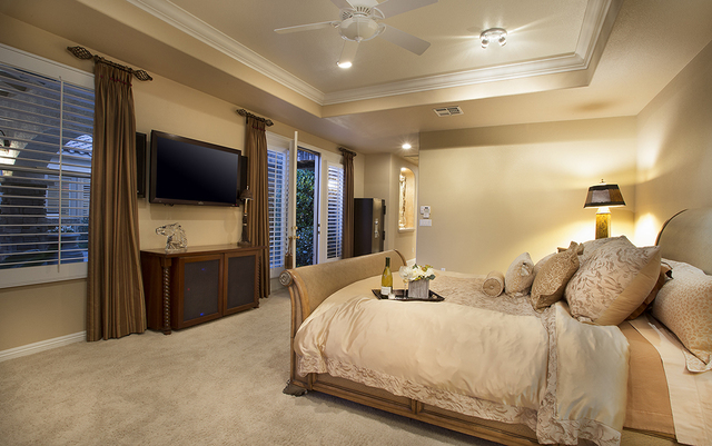 The master bedroom in the home at 11856 Brigadoon Drive in Southern Highlands (Synergy, Sotheby's International Realty)