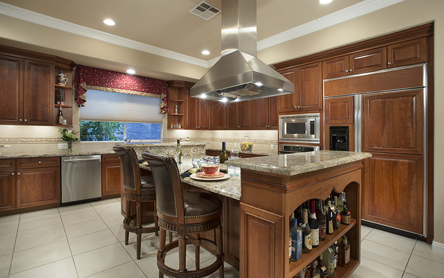 The kitchen at the home at 11856 Brigadoon Drive in Southern Highlands. (COURTESY OF SYNERGY, SOTHEBY'S INTERNATIONAL REALTY)