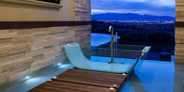 Sun West Custom Homes' showcase home features a master bath that can be open to the pool area and the Las Vegas skyline. (Courtesy Sun West Custom Homes)