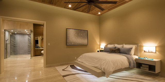 The master bedroom opens to a large bath and shower. (Courtesy Sun West Custom Homes)