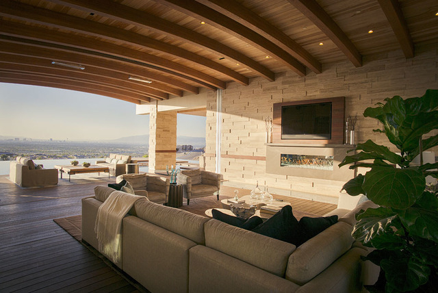 The living area flows into the pool patio. (Courtesy Sun West Custom Homes)
