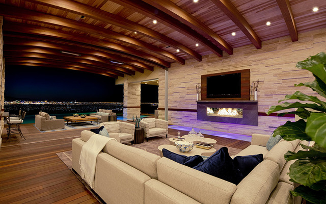 The living room area opens to the pool. (Courtesy Sun West Custom Homes)
