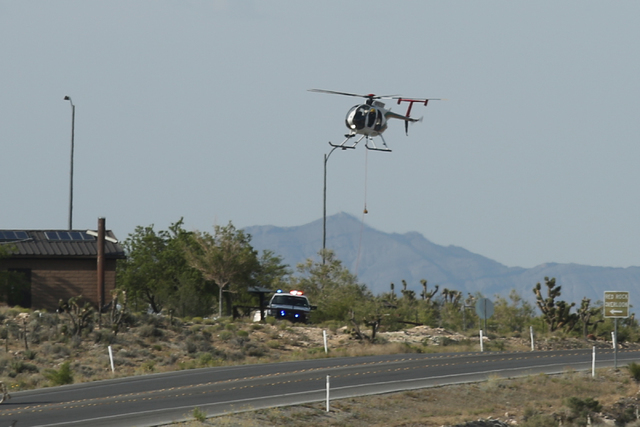 A Metro helicopter is used in a recovery effort at the overlook on Red Rock Canyon Road in Las Vegas on Saturday, May 28, 2016. (Brett Le Blanc/Las Vegas Review-Journal) Follow @bleblancphoto