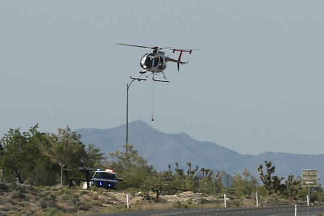 A Metro helicopter is used in a recovery effort at the overlook on Red Rock Canyon Road in Las Vegas on Saturday, May 28, 2016. (Brett Le Blanc/Las Vegas Review-Journal)