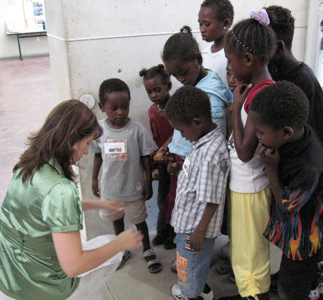 A volunteer is seen interacting with refugee children at Catholic Charities of Southern Nevada, 1501 Las Vegas Blvd. North. (Special to View)