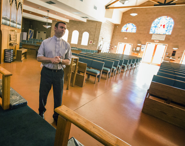 Rev. Michael Engfer stands inside All Saints Episcopal Church, 4201 W. Washington Ave., on Wednesday, May 4,2016. Engfer, serves both All Saints Episcopal Church and the Air Force Reserves as a ch ...