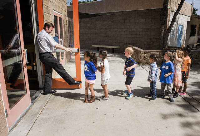 Rev. Michael Engfer opens the door for  students at All Saints Episcopal Church, 4201 W. Washington Ave., on Wednesday, May 4,2016. Engfer, serves both All Saints Episcopal Church and the Air Forc ...