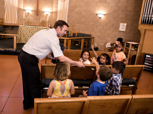 Rev. Michael Engfer performs a magic act with students at  All Saints Episcopal Church, 4201 W. Washington Ave., on Wednesday, May 4,2016. Engfer, serves both All Saints Episcopal Church and the A ...