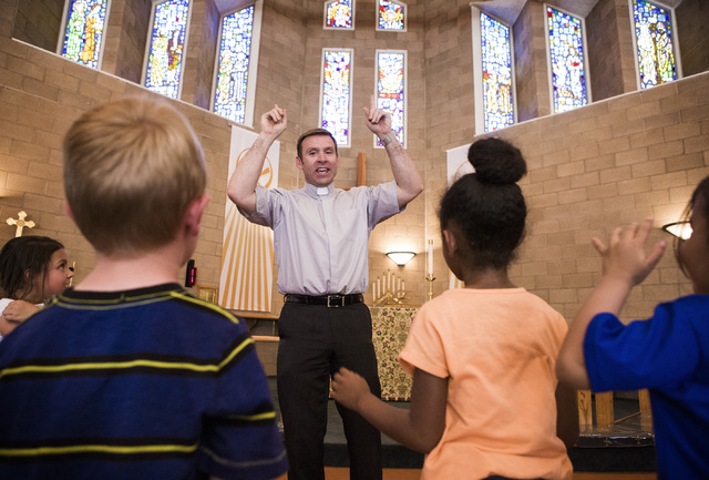 Rev. Michael Engfer performs a song with students at All Saints Episcopal Church, 4201 W. Washington Ave., on Wednesday, May 4,2016. Engfer, serves both All Saints Episcopal Church and the Air For ...