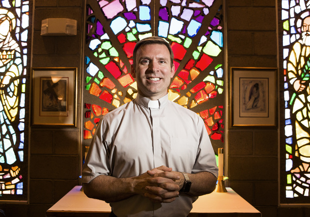Rev. Michael Engfer stands beside a stain glass window at  All Saints Episcopal Church, 4201 W. Washington Ave., on Wednesday, May 4,2016. Engfer, serves both All Saints Episcopal Church and the A ...