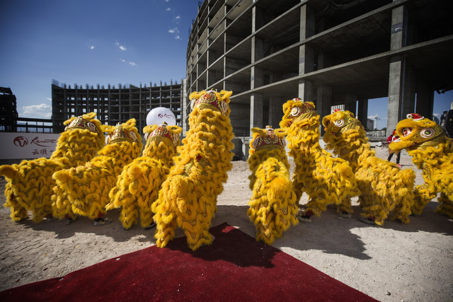 Members of the Resorts World Lion Dancers perform  during the groundbreaking of  the $4 billion Resorts World Las Vegas resort property, the site of the former Stardust hotel-casino on Tuesday, Ma ...